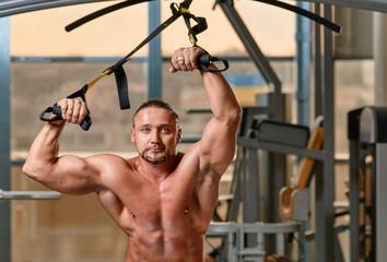 fitness TRX man workout portrait