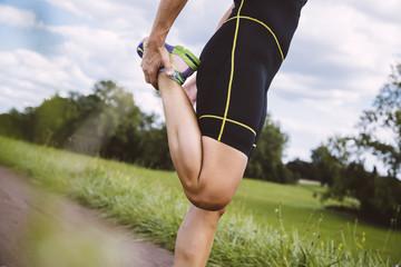 Female triathlete preparing for run