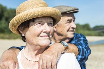 Senior couple relaxing at riverside