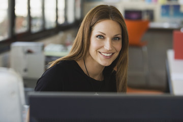Young woman in office, portrait