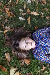 Portrait of girl lying on a meadow