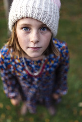 Portrait of serious looking girl wearing woollen cap