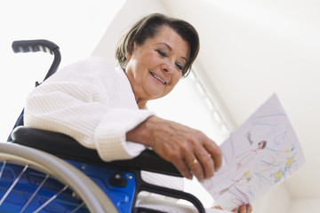 Germany, Leipzig, Senior woman sitting on wheelchair