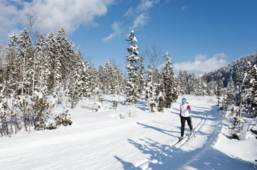 Germany, Bavaria, Aschermoos, Senior woman doing cross country skiing