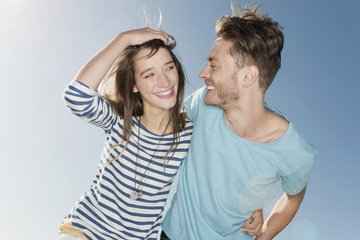 Germany, Berlin, Young couple laughing, portrait