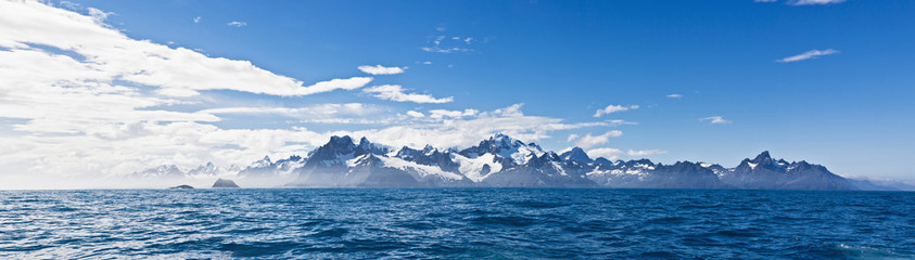 South Atlantic Ocean, United Kingdom, British Overseas Territories, South Georgia, View of sea with mountains in background