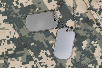 Close up of military uniform and identification tags with chain
