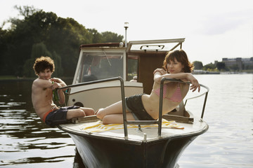 Germany, Berlin, Young couple on motor boat