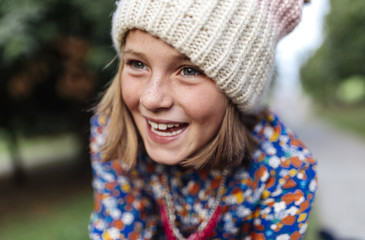 Portrait of smiling girl wearing knit hat