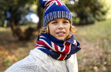 Portrait of blond boy wearing fashionable knit wear in autumn