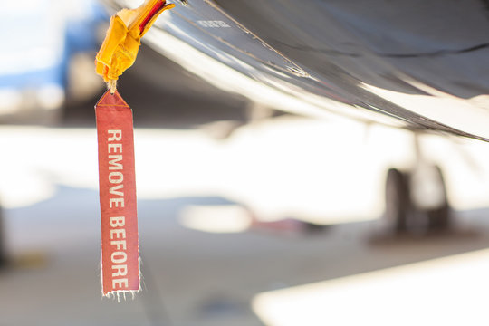 Red Remove Before Flight Tag on an airplane fuselage