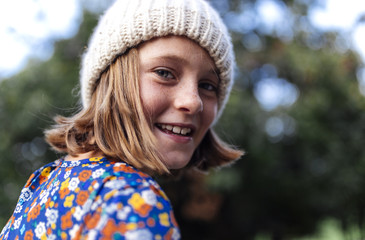 Portrait of smiling girl wearing knit hat