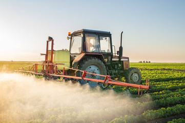 Tractor spraying soybean