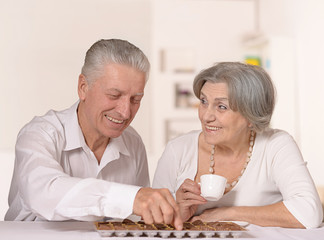 Old couple with chocolate candies