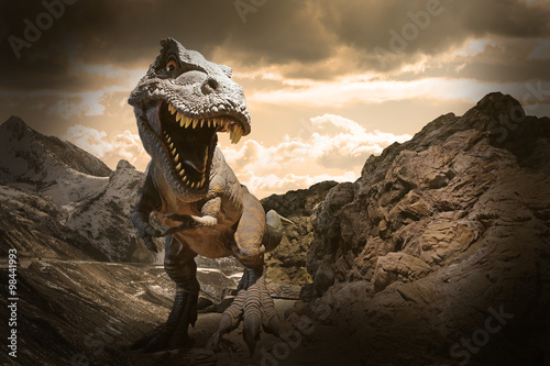 Dinosaurs model on rock mountain background