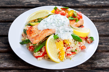 Pan fried Salmon with tender asparagus, courgette served on couscous mixed with sweet tomato, yellow pepper, with greek yogurt