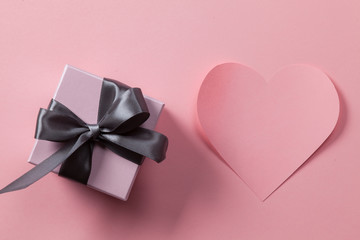 Gift and Valentines card on pink background