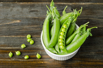 Fresh green pea on wooden background