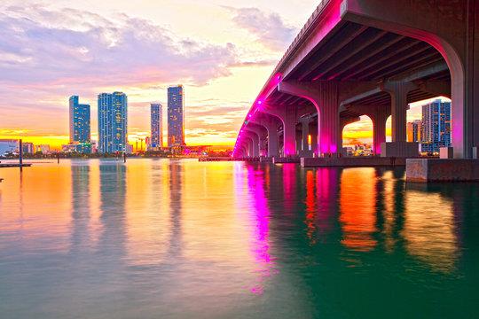 Miami Florida at sunset, colorful skyline of illuminated buildings and Macarthur causeway bridge