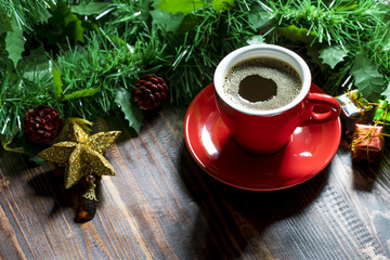 Cup of coffee with Christmas decorations.