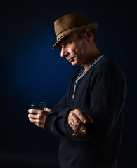 man with hat smoking cigar
