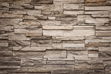 Grunge brown brick wall with copy space, vintage color tone