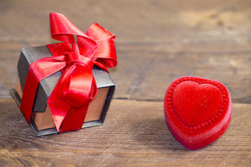 gift box and a red heart on a wooden background