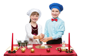 Children cooking christmas dessert