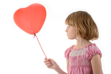 Little girl in pink dress holding a balloon