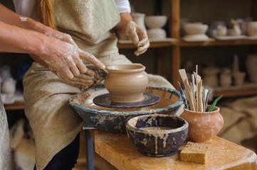 Potter teaches how make clay pot