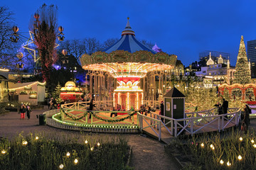 Evening view of carousel and christmas illumination in Tivoli Gardens in Copenhagen, Denmark