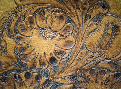 Brown leatherwork carved detail on saddle.