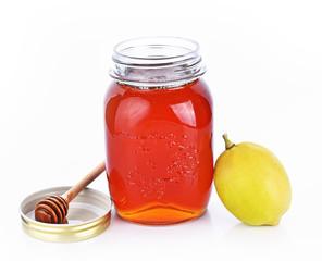 Bottle honey ,lemon on white background