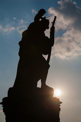 Prague - Silhouette of st. Christopher statue from Charles bridge