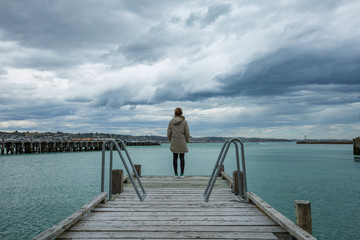 woman stand at the edge of the bridge