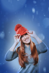 Vivacious redhead in a festive red hat