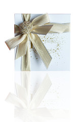 Gift box tied with a bow on white background.