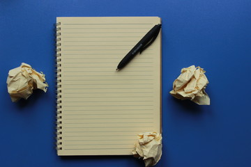 screenwriter and pen, paper with notebook