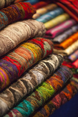 Colorful silk and wool scarfs in a market