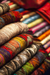 Colorful  wool scarfs in a market