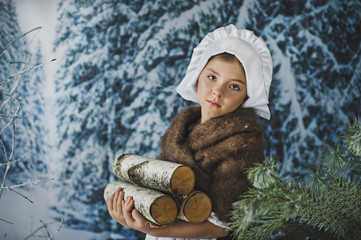 Little girl in the winter forest collect firewood 4825.