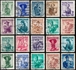 Stamps printed in Austria, show women in national dress