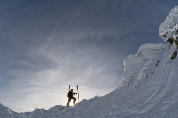 skier on a mountain ridge in the winter