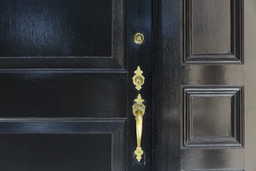 front door, close up of black front door with brass handle