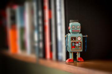 Vintage tin toy robot on a book shelf