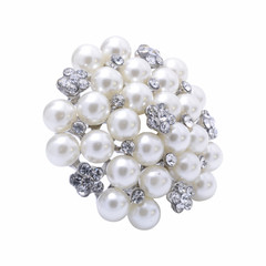 round brooch with pearls isolated on white