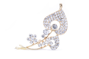 Wall Mural - gold brooch with diamonds isolated on white
