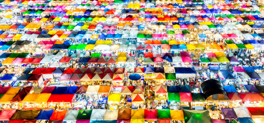Top view of Night market with many store for service customer in Bangkok, Thailand. Train Market is new favorite shoping center of bangkok.