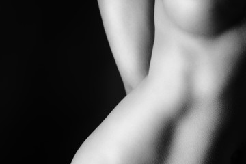 Naked woman breast and hip