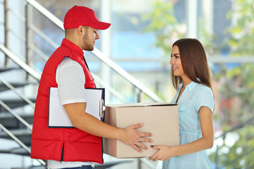Young woman and courier - delivery concept